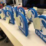 Twelve SPR Rooms sensors housed in blue 3D printed casings sitting on a table