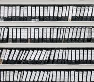 hundreds of binders sitting on selves