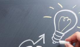 Drawing light bulb on blackboard