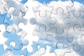 pieces of a jigsaw puzzle forming clouds