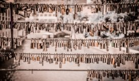 Scores of padlocks hang from 5 cables