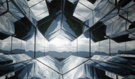 View of a mountain range from a hexagonal glass kaleidoscope