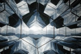 View of a mountain range from a hexagonal glass kaleidoscope
