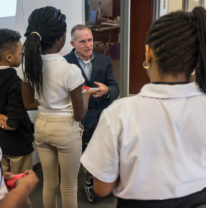 Pat Maher speaks with students from LEARN Charter at SPR's office.